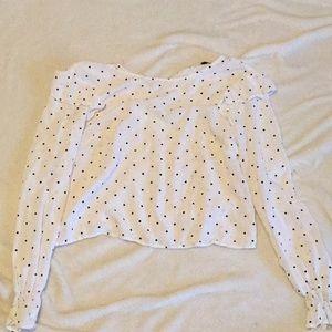 White with black polka dot blouse